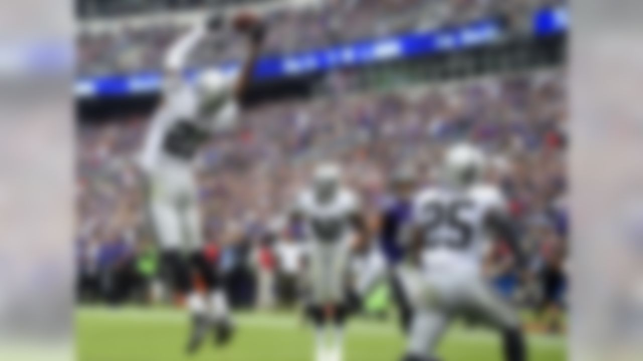 Oakland Raiders cornerback Sean Smith (21) intercepts a two-point conversion attempt in the end zone in the second half of an NFL football game against the Baltimore Ravens, Sunday, Oct. 2, 2016, in Baltimore. (AP Photo/Nick Wass)