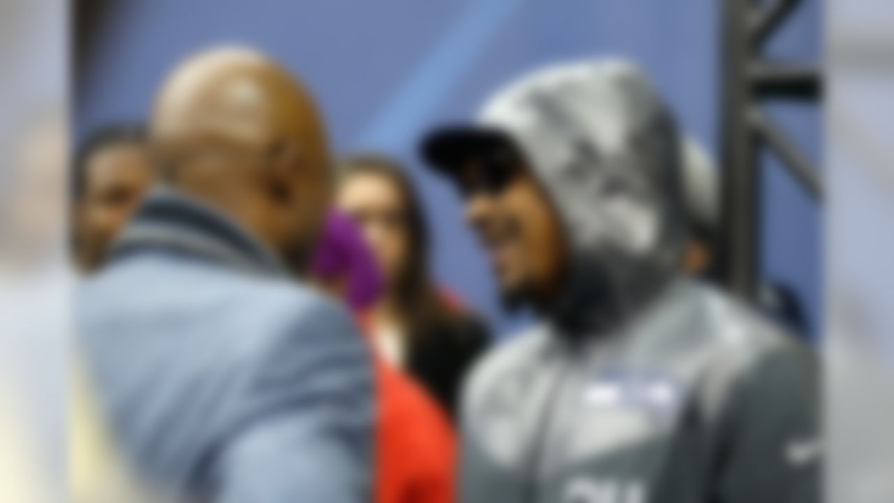 Seattle Seahawks running back Marshawn Lynch, right, speaks with NFL Network's Deion Sanders during the Super Bowl XLVIII Media Day at the Prudential Center on Tuesday, January 28, 2014 in Newark, NJ. (Perry Knotts/NFL)