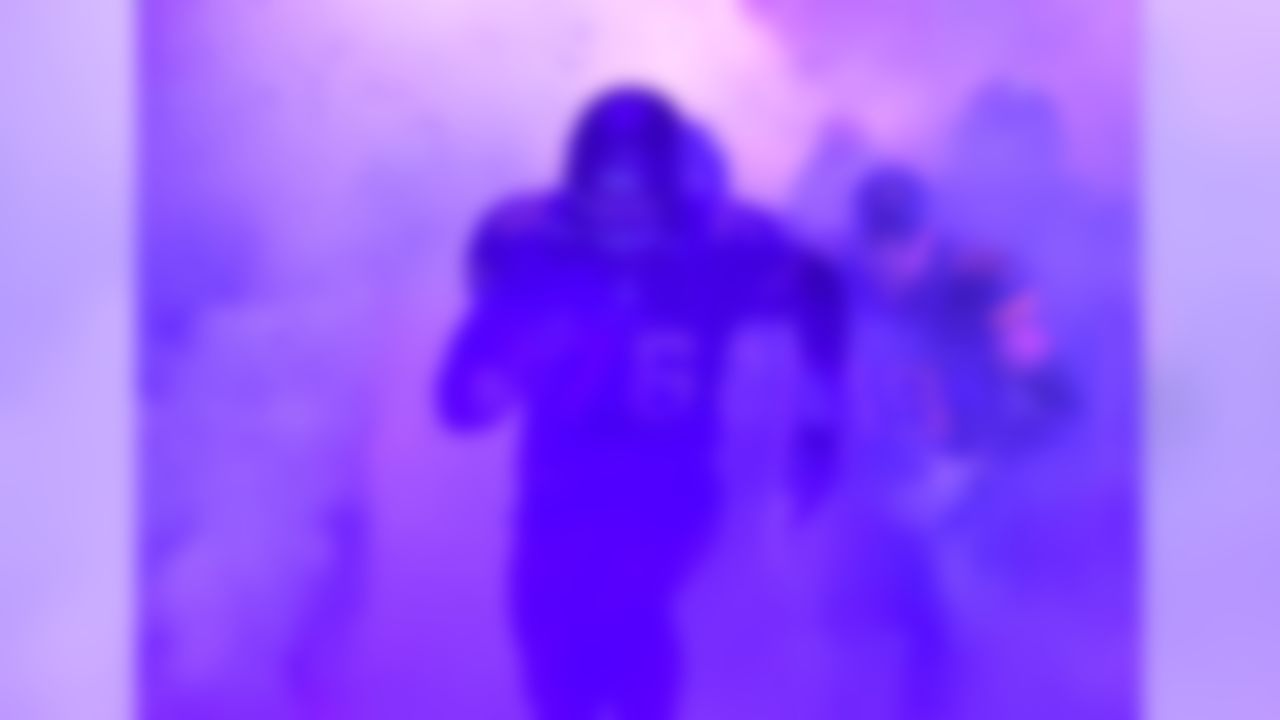 General overall view as Minnesota Vikings guard Alex Boone (76) enters the field through smoke and purple confetti during a NFL football game against the Dallas Cowboys  in Minneapolis, MN on Thursday, Dec 1, 2016. The Vikings defeated the Cowboys 17-15. (Kirby Lee/NFL)