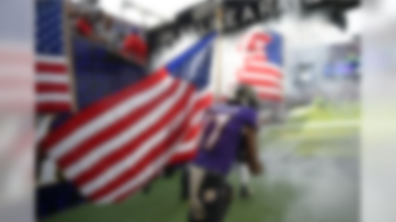 Baltimore Ravens wide receiver Mike Wallace (17) runs onto the field with an American flag before an NFL football game against the Pittsburgh Steelers, Sunday, Nov. 6, 2016, in Baltimore. (AP Photo/Nick Wass)