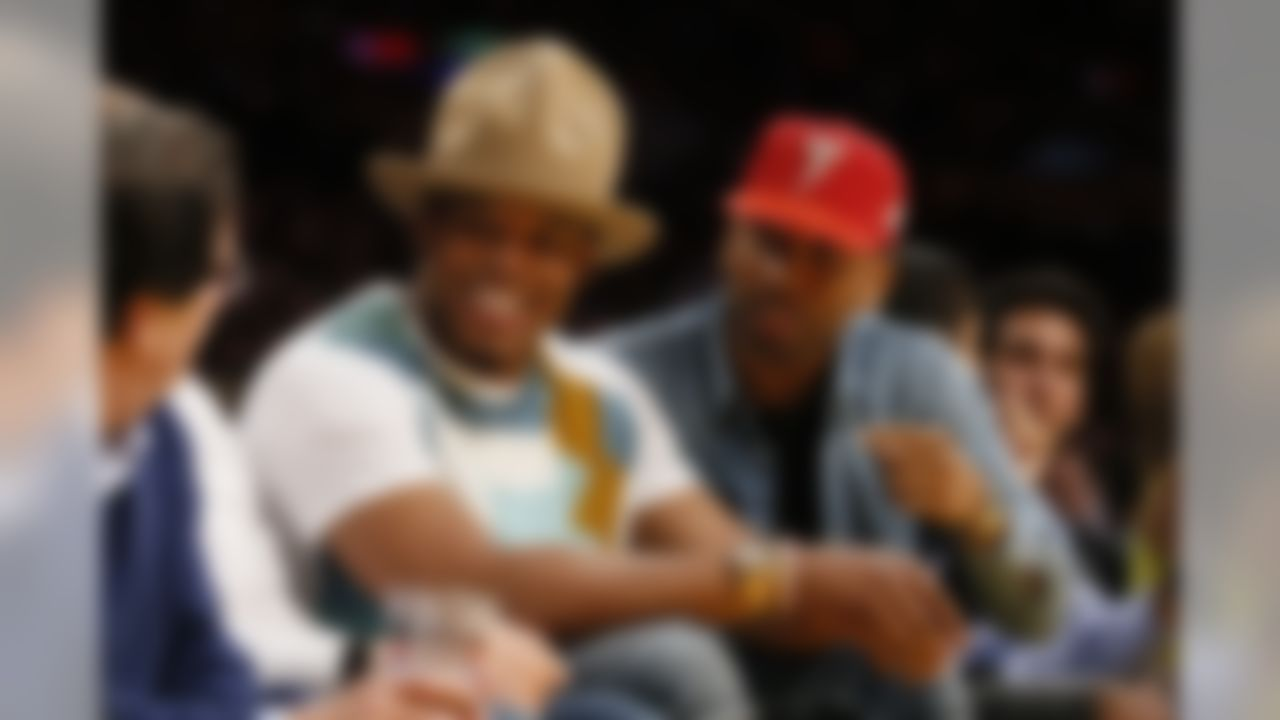 NFL quarterback Cam Newton, left, and Cleveland Cavaliers' LeBron James' business manager Maverick Carter, right, sit courtside during the NBA basketball game between the Los Angeles Lakers and Cleveland Cavaliers Thursday, March 10, 2016, in Los Angeles. The Cavaliers won 120-108. (AP Photo/Danny Moloshok)