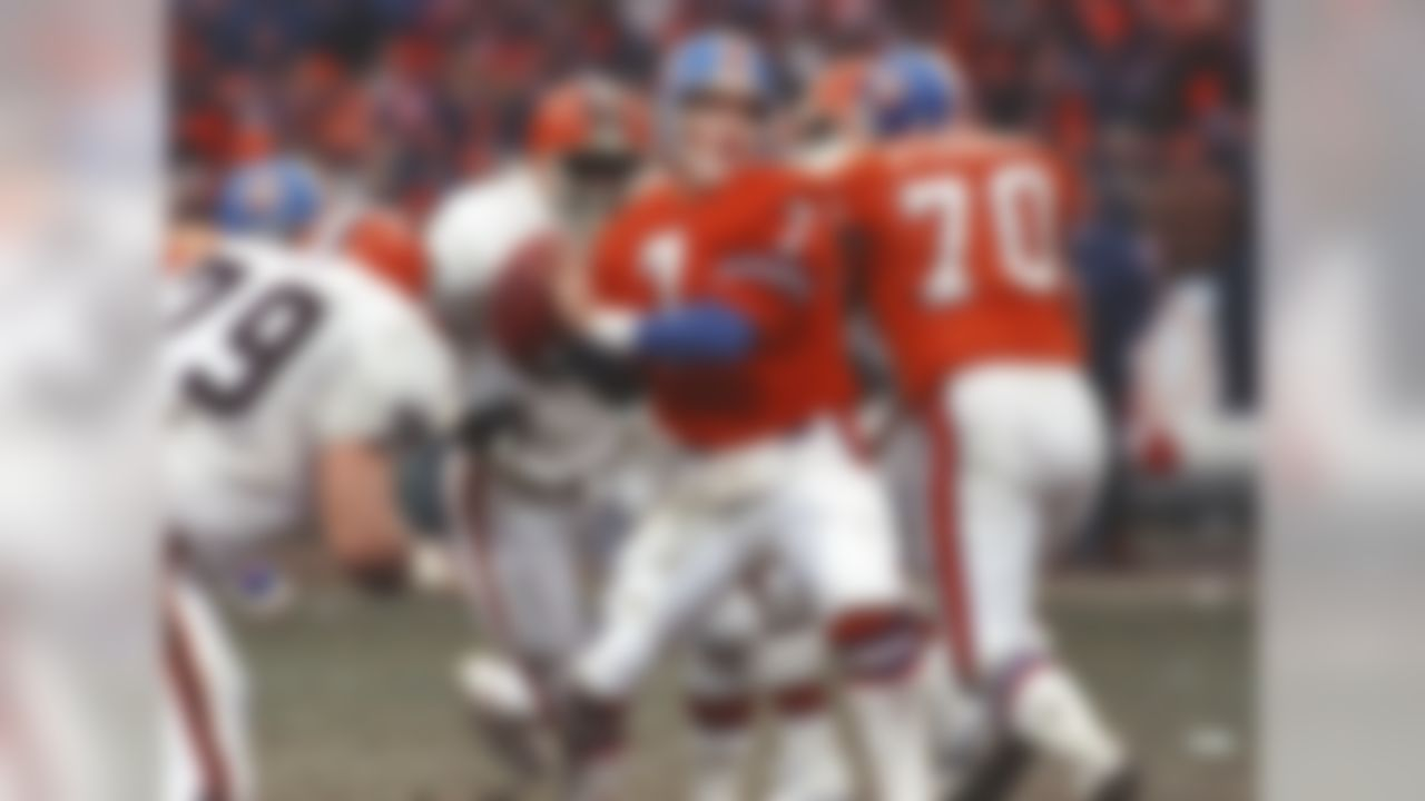 Draft: 1983 College: Stanford NFL career: 16 seasons. Denver Broncos, 1983-1998.  There have been 31 quarterbacks (33 if you count the American Football League drafts of 1961-66, which we will in this exercise ... more on that later) taken with the No. 1 overall draft selection in the NFL draft (dating back to 1936). Four of those quarterbacks are in the Pro Football Hall of Fame (Elway, Troy Aikman, Terry Bradshaw and Joe Namath -- Namath was a No. 1 overall pick in the American Football League draft). Five years after retiring, Peyton Manning will join them in Canton.  On top of being one of the most prolific passers in the game's history, Elway was also an accomplished scrambler; adding 3,407 yards and 33 touchdowns rushing to his 51,475 yards and 300 touchdowns passing. Elway took the Broncos to five Super Bowls, winning the final two to finish his career in spectacular style.