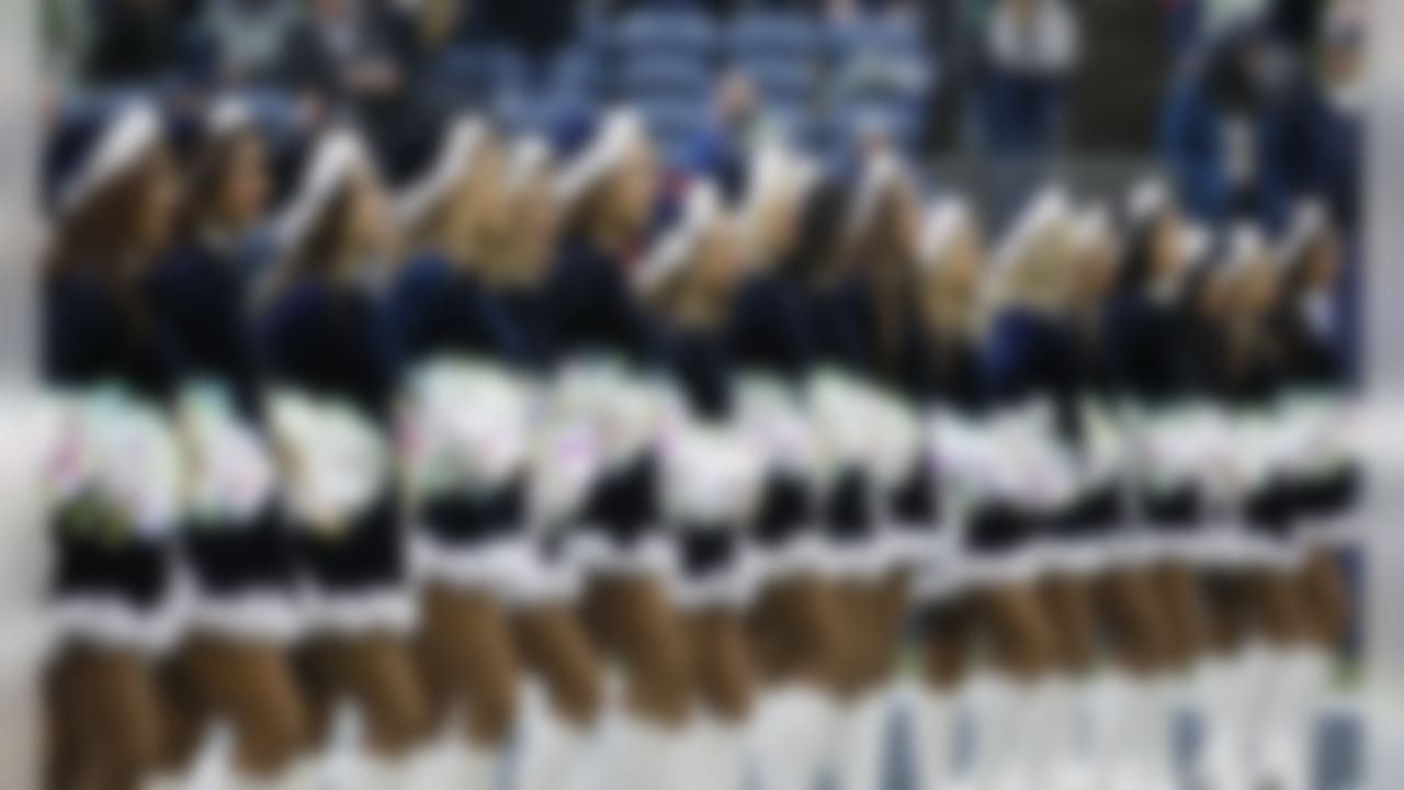 Seattle Seahawks Sea Gals cheerleaders perform before an NFL football game against the Los Angeles Rams, Sunday, Dec. 17, 2017, in Seattle.