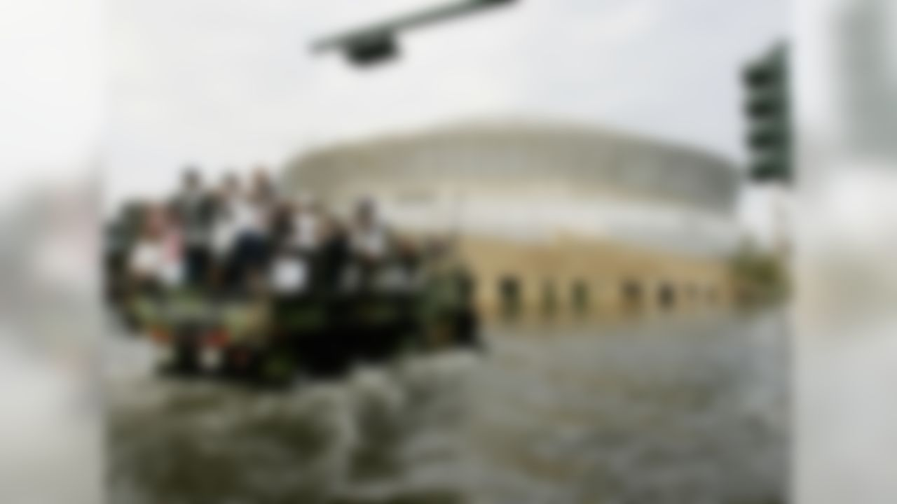 National Guard trucks haul residents through floodwaters to the Superdome after Hurricane Katrina hit in New Orleans, Tuesday, Aug. 30,  2005. Officials called for a mandatory evacuation of the city, but many residents remained.
