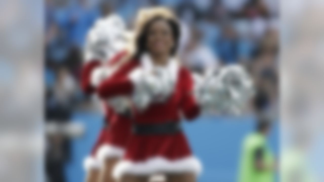 Carolina Panthers cheerleaders perform in the first half of an NFL football game against the Atlanta Falcons in Charlotte, N.C., Sunday, Dec. 13, 2015. (AP Photo/Bob Leverone)