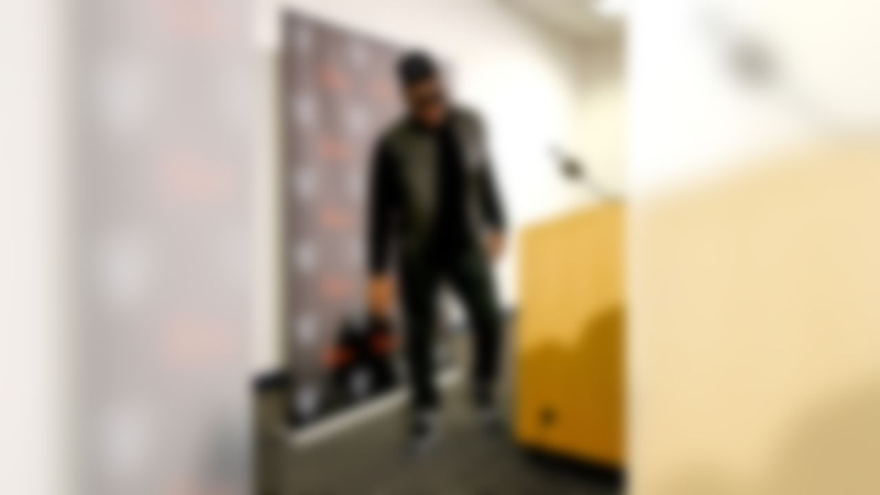 Oakland Raiders defensive end Khalil Mack leaves the stage after a post game news conference after an NFL football game against the Denver Broncos, Sunday, Dec. 13, 2015, in Denver. The Raiders won 15-12. (AP Photo/Joe Mahoney)