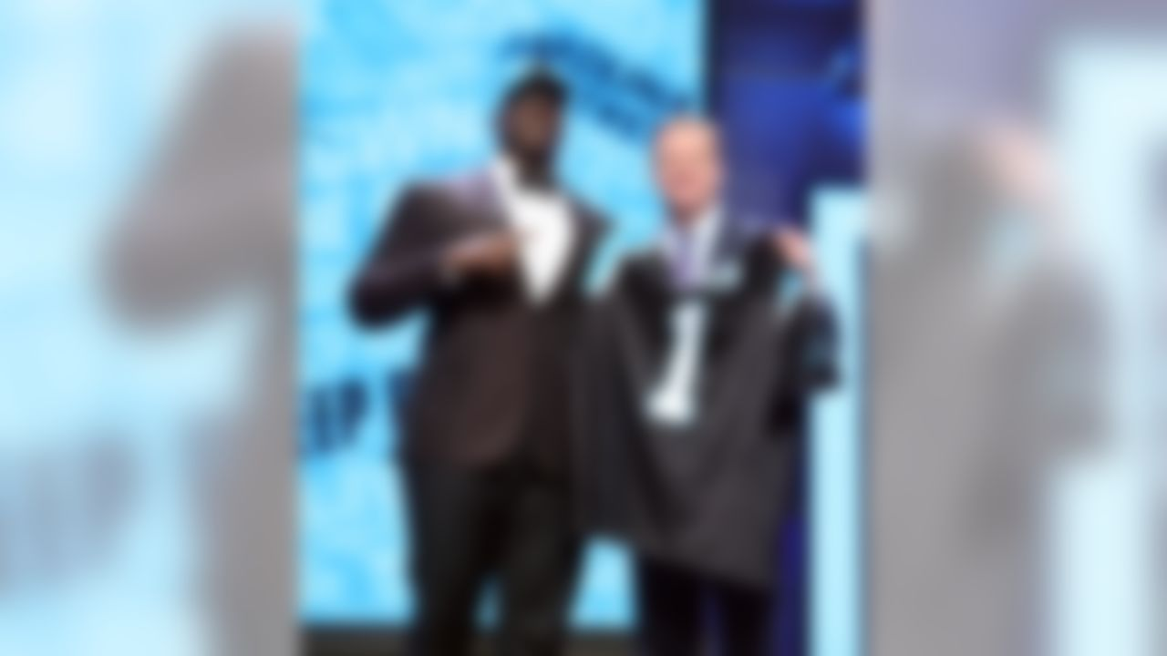 Louisiana Tech defensive tackle Vernon Butler holds up his jersey with NFL Commissioner Roger Goodell after being drafted by the Carolina Panthers during the 2016 NFL Draft at the Auditorium Theatre on Thursday, April 28, 2016 in Chicago. (Perry Knotts/NFL)