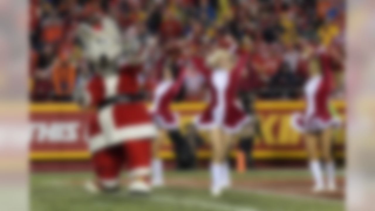 Kansas City Chiefs mascot and Chiefs cheerleaders perform in Christmas costumes during a NFL football game against the Denver Broncos in Kansas City, Mo, on Sunday, Dec. 25, 2016. (Kirby Lee/NFL)