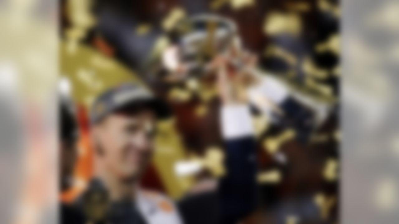 Denver Broncos� Peyton Manning holds up the trophy after the NFL Super Bowl 50 football game Sunday, Feb. 7, 2016, in Santa Clara, Calif. The Broncos won 24-10. (AP Photo/Matt York)