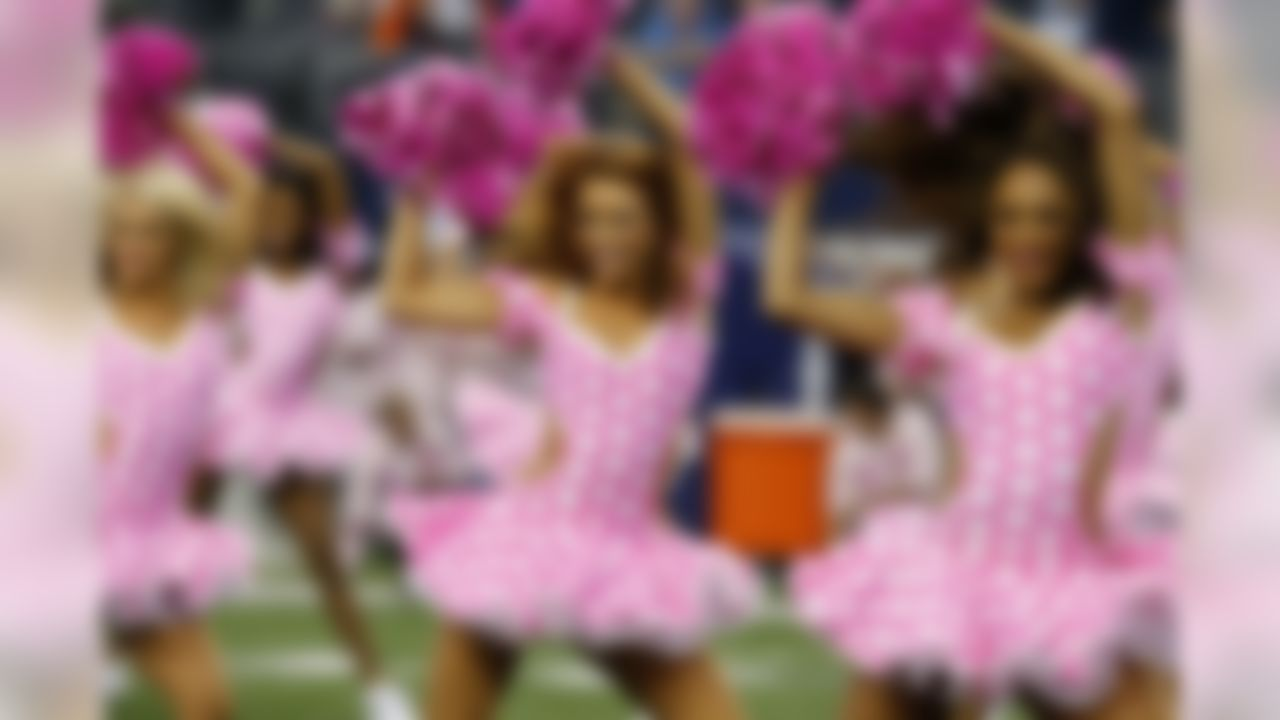 Dallas Cowboys cheerleaders wear pink in support of breast cancer awareness during the halftime show of an NFL football game Sunday, Oct. 6,2013, in Arlington, Texas. (AP Photo/Sharon Ellman)