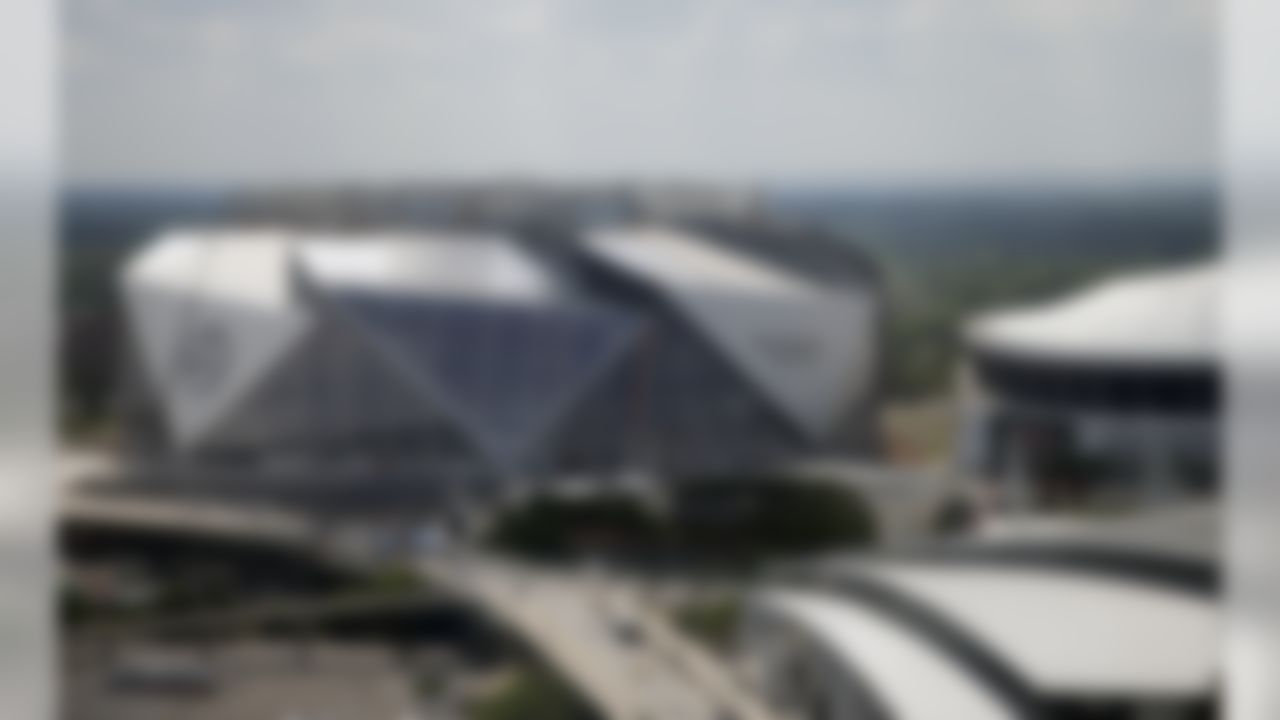 Mercedes-Benz Stadium the future home of the Atlanta Falcons is shown next to theGeorgia Dome, right, Friday, May 19, 2017, in Atlanta. (AP Photo/John Bazemore)