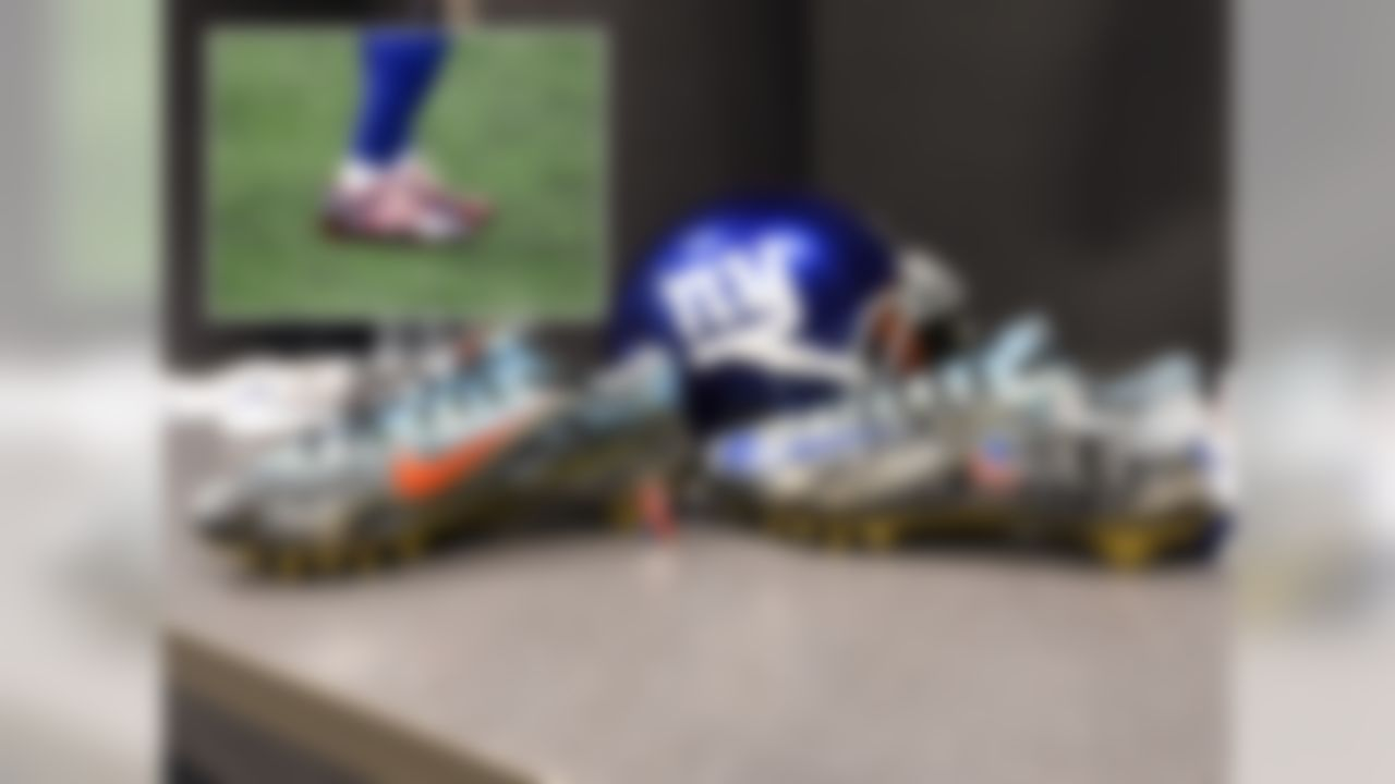 Odell Beckham won last year.  He wore unique cleats almost every single week. He wore cleats on Thanksgiving that featured Snoopy and Charlie Brown.  For Christmas? This man wore Nike Vapor Carbons with Christmas lights in the side panel and presents on the laces. For Week 1 of the new season, Beckham elected to wear a pair of cleats that featured hand painted images of the 9/11 first responders working at the base of the building and hoisting the flag. For his pregame warmups Beckham wore Nike Vapor Carbons that featured red and white stripes with blue swooshes featuring small white stars.