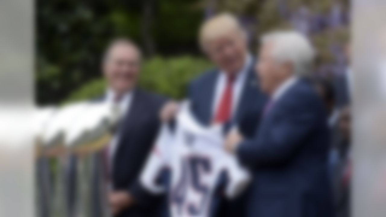 President Donald Trump is presented with a New England Patriots jersey from Patriots owner Robert Kraft, right, and head coach Bill Belichick during a ceremony on the South Lawn of the White House in Washington, Wednesday, April 19, 2017, where the president honored the Super Bowl Champion New England Patriots for their Super Bowl LI victory. (Susan Walsh/Associated Press)