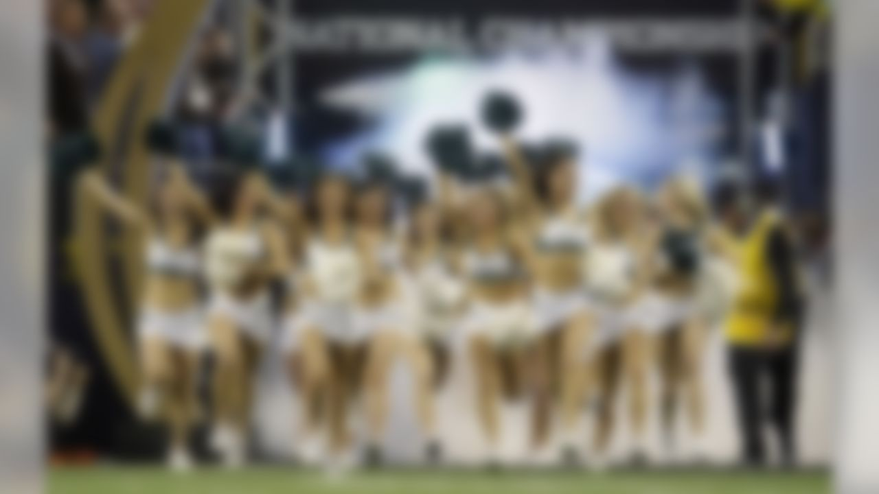 Oregon cheerleaders take the field before the NCAA college football playoff championship game against Ohio State Monday, Jan. 12, 2015, in Arlington, Texas. (AP Photo/LM Otero)