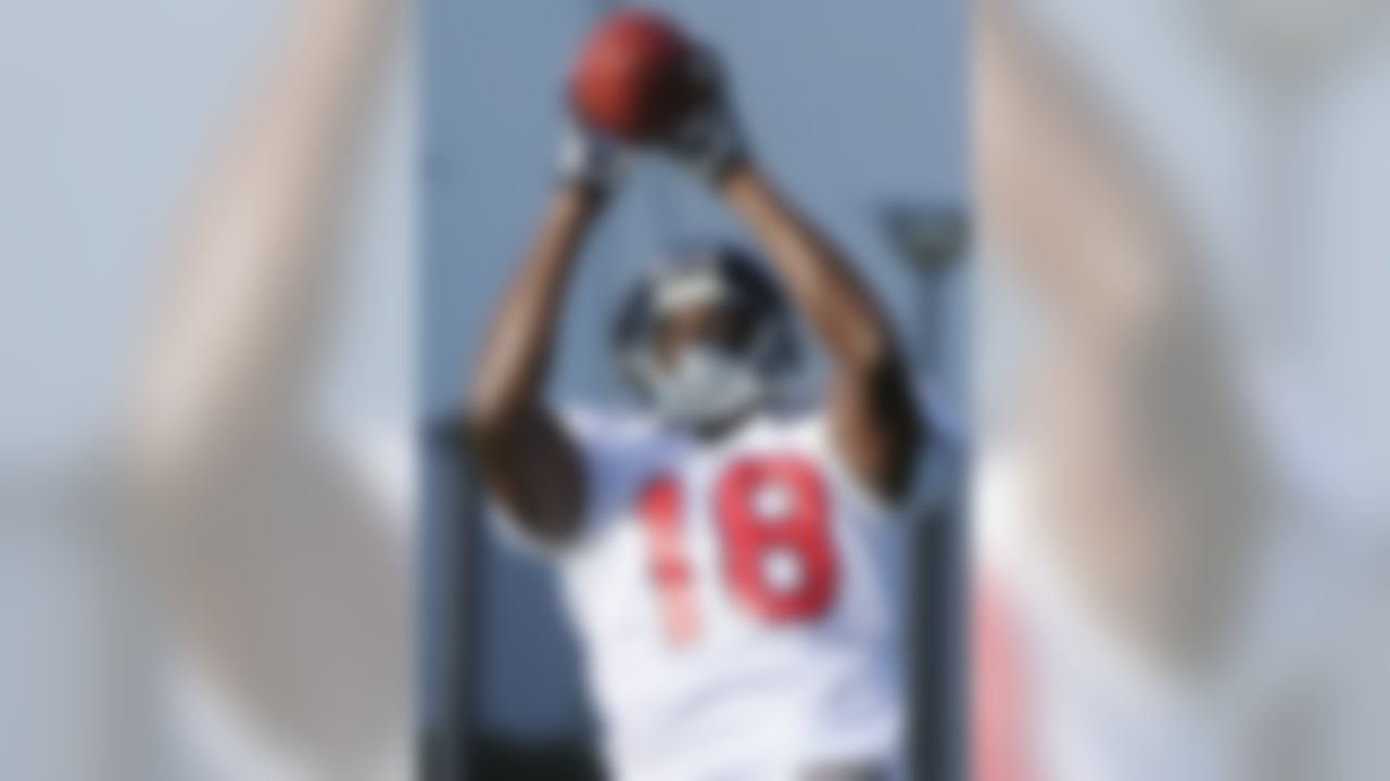 Houston Texans' Lestar Jean catches a pass during drills at training camp Monday, July 30, 2012, in Houston. (AP Photo/Pat Sullivan)