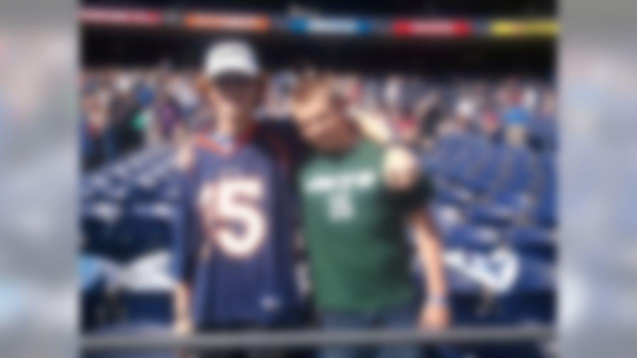 Tim Tebow fans Matthew Shippey and David Zinck pose for a photograph before watching New York Jets quarterback Tim Tebow deliver a sermon at Qualcomm Stadium in San Diego, California on June 17, 2012.  (Kenny Legan/NFL)