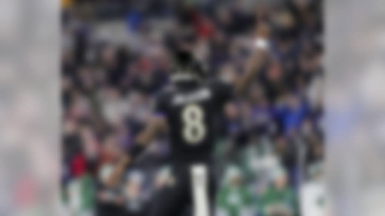 Baltimore Ravens quarterback Lamar Jackson (8) celebrates a touchdown during an NFL football game against the New York Jets, Thursday, Dec. 12, 2019 in Baltimore, Md.