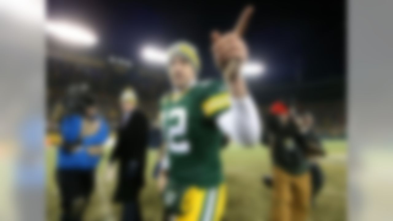 1) Aaron Rodgers, Green Bay Packers - $22,000,000 yearly average Five years, $110,000,000 total with $54,000,000 guaranteed (Todd Rosenberg/NFL)