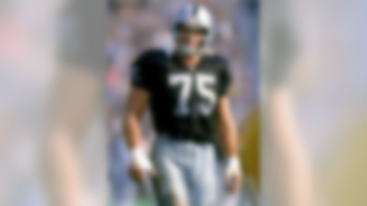 LOS ANGELES - 1991:  Defensive lineman Howie Long #75 of the Los Angeles Raiders looks on during a 1991 NFL season game at Los Angeles Memorial Coliseum in Los Angeles, California.  (Photo by Stephen Dunn/Getty Images)
