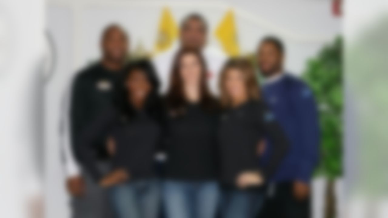 Back row: Sammy Morris, Willie Roaf, Josh Wilson Front row: Raiderettes Jovann Walker, Ariel Ogilvie, Meena Shams