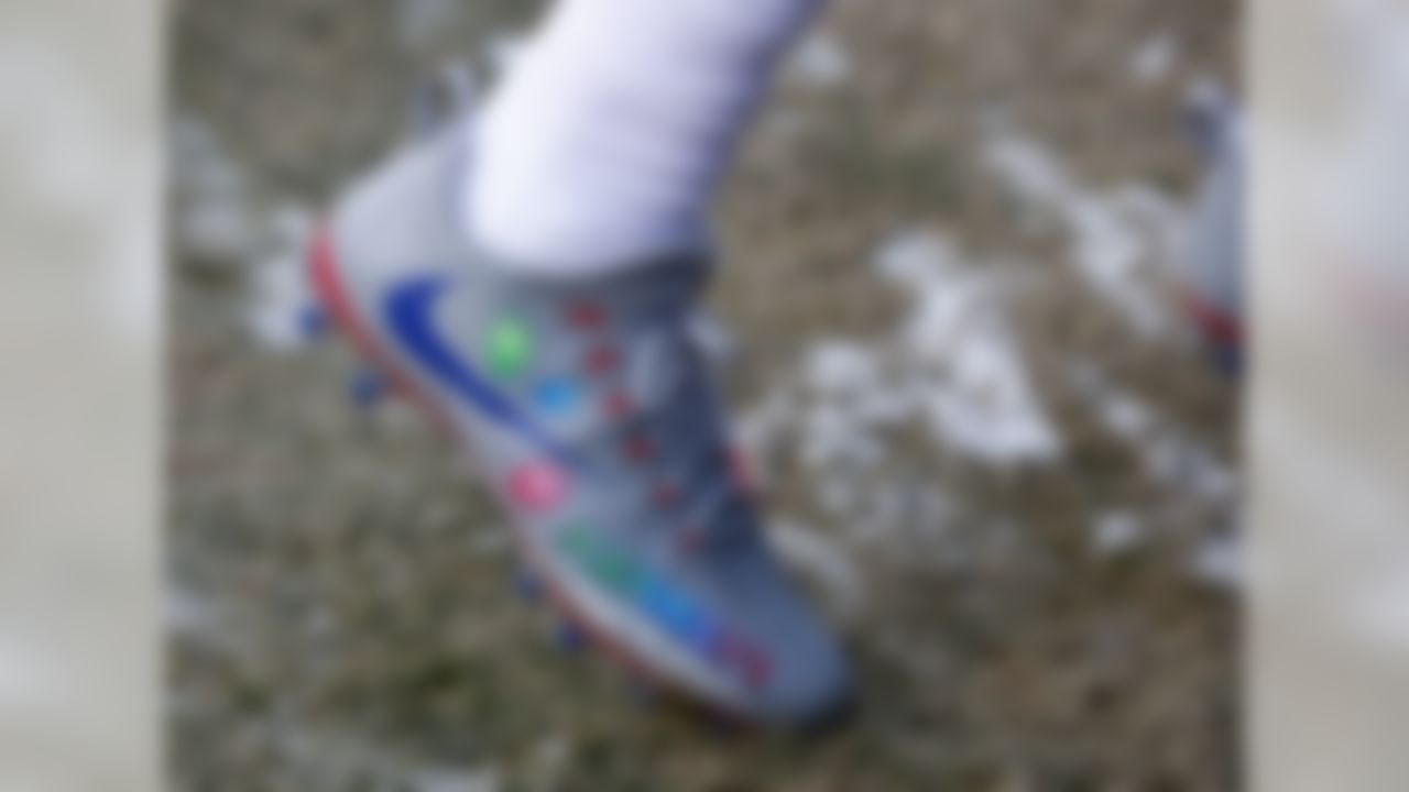 """Cruz looked like his old self during the Giants' game in Green Bay. Cruz wore these special cleats in honor of his daughter's birthday. The cleats used a base grey with a blue swoosh and red base. They also had balloons, confetti and a message that said, """"Happy Birthday Kennedy."""""""