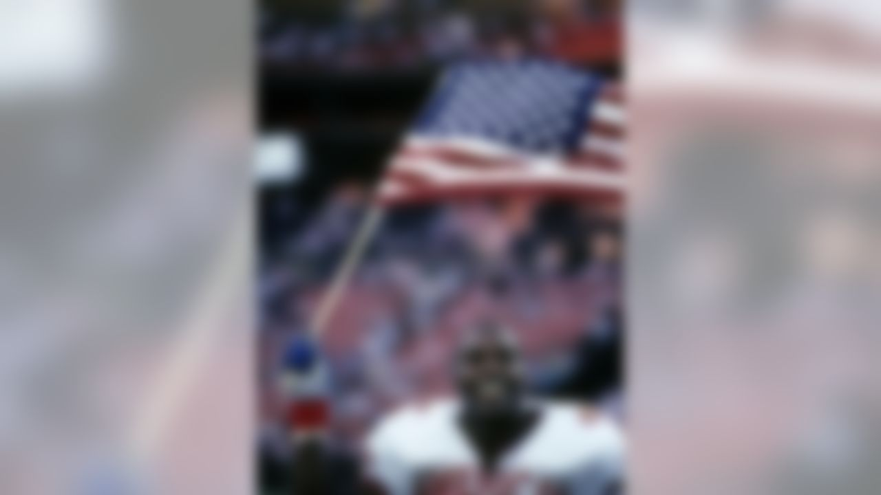 AFC linebacker Derrick Thomas (57) of the Kansas City Chiefs waves an American flag as he leaves the field following the AFC's 23-21 victory over the NFC in the 1991 NFL Pro Bowl played on February 3, 1991 at Aloha Stadium in Honolulu, Hawaii. Photo by NFL/WireImage.com