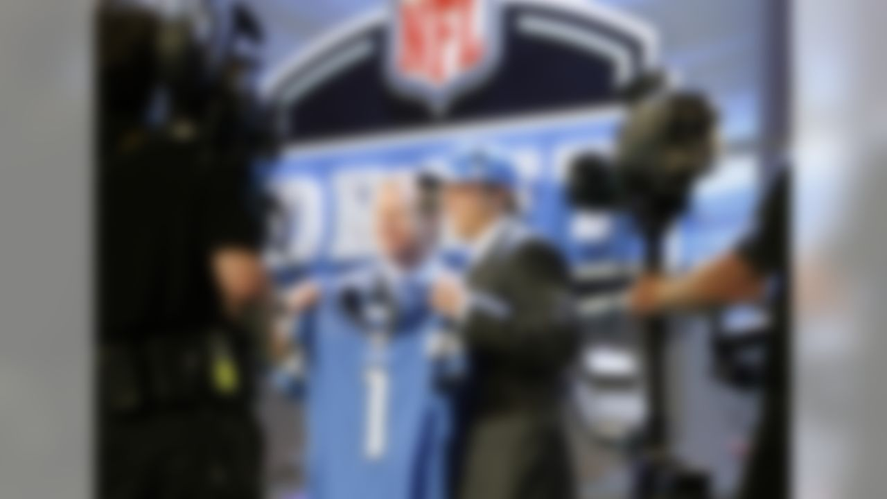 Georgia's Matthew Stafford, right, holds up a jersey with NFL commissioner Roger Goodell, after the Detroit Lions selected Stafford as the No. 1 overall pick in the NFL Draft at Radio City Music Hall Saturday,  April 25, 2009,  in New York. (Ben Liebenberg/NFL)
