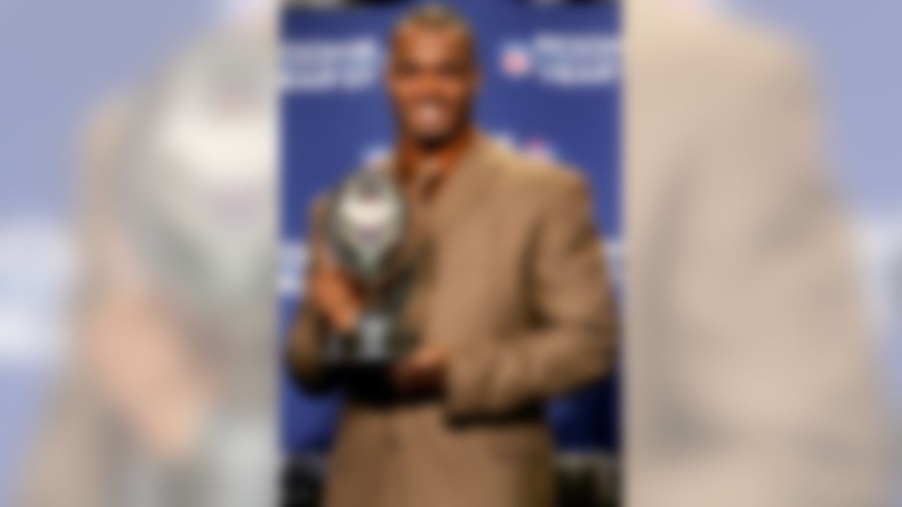 PHOENIX - JANUARY 31:  Running back Adrian Peterson of the Minnesota Vikings accepts the 2007 Diet Pepsi NFL Rookie of the Year Award at a news conference prior to Super Bowl XLII at the Phoenix Convention Center on January 31, 2008 in Phoenix, Arizona.  (Photo by Streeter Lecka/Getty Images)