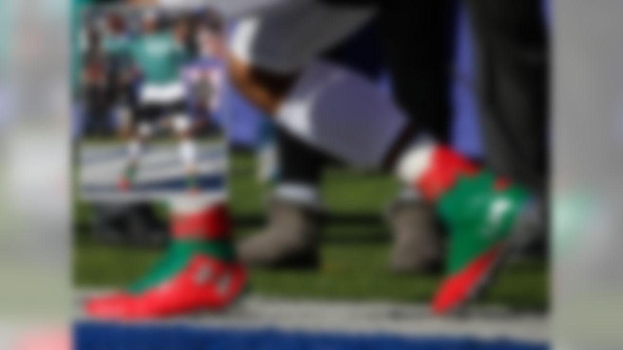 Cam Newton chose to spend his time warming up wearing an Under Armour Green Lantern Alter Ego long sleeve and these C1N1 Christmas colorway cleats. Newton played the role of the Grinch, as he and the Carolina Panthers managed to pull out another clutch victory over Odell Beckham Jr. and the New York Giants.