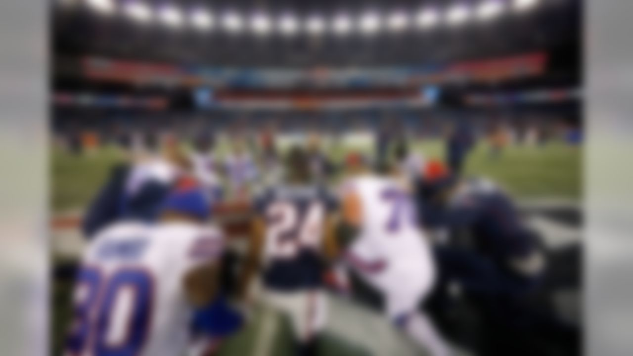 Players from the Buffalo Bills and the New England join hands in prayer following an NFL football game at Gillette Stadium on Monday, Nov. 23, 2015, in Foxborough, Mass. (Aaron M. Sprecher/NFL)