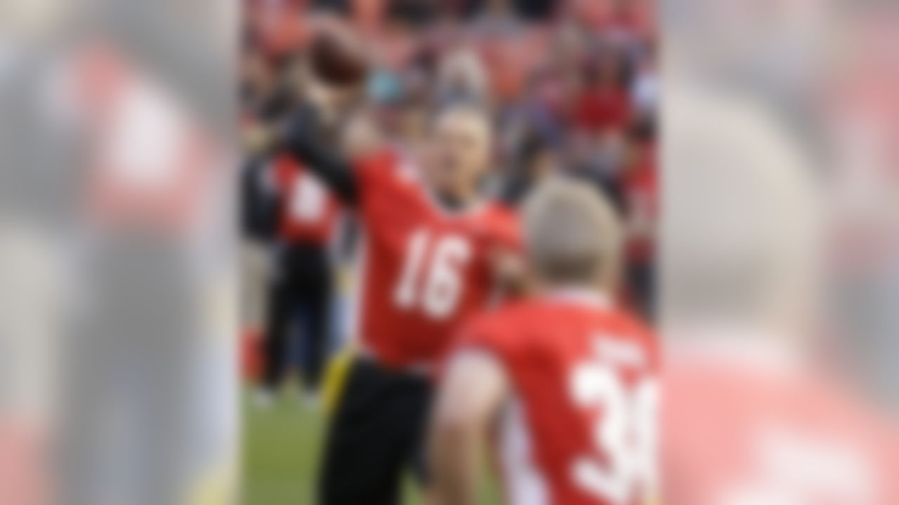 """Hall of Fame quarterback Joe Montana, left, passes the ball to running back Bill Ring, right, during the """"Legends of Candlestick"""" flag football game Saturday, July 12, 2014, in San Francisco. The game between former San Francisco 49er greats and a team of former NFL stars captained by Hall of Famer Dan Marino is the final one to be played at Candlestick Park.  The park, which opened in 1960 and was also the home of the San Francisco Giants baseball team until 1999, is slated for demolition in the next year. (Eric Risberg/Associated Press)"""