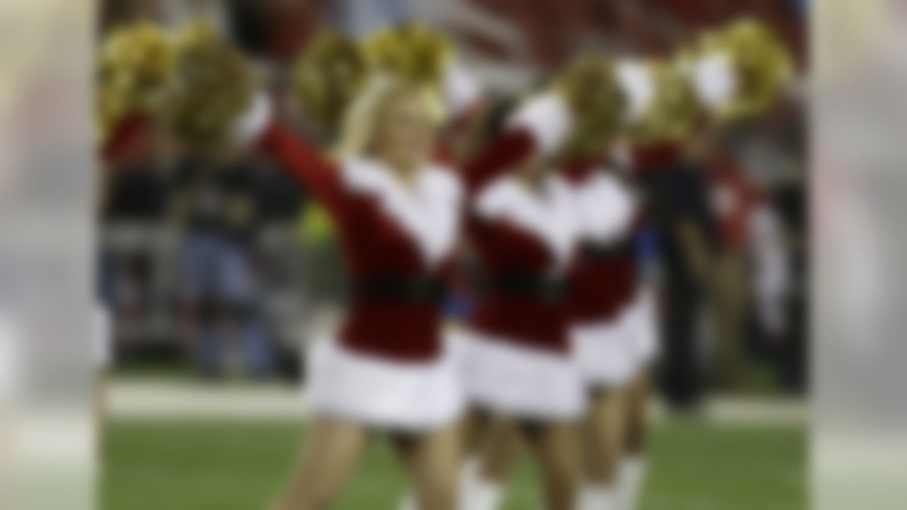 San Francisco 49ers cheerleaders perform during the first half of an NFL football game between the San Francisco 49ers and the San Diego Chargers in Santa Clara, Calif., Saturday, Dec. 20, 2014. (AP Photo/Ben Margot)