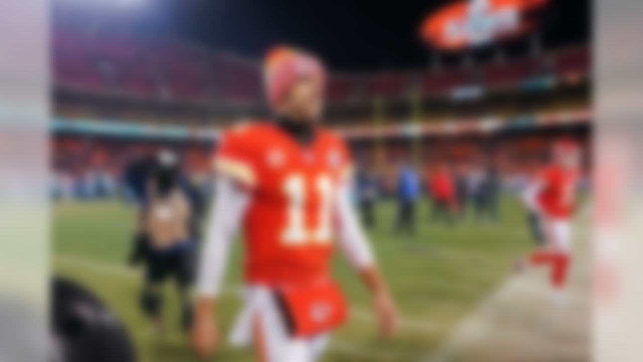 Kansas City Chiefs quarterback Alex Smith (11) walks off the field following the AFC wild-card game against the Tennessee Titans. The Chiefs lost to the Titans 22-21 in what many speculate to be Smith's last game as a Chief.