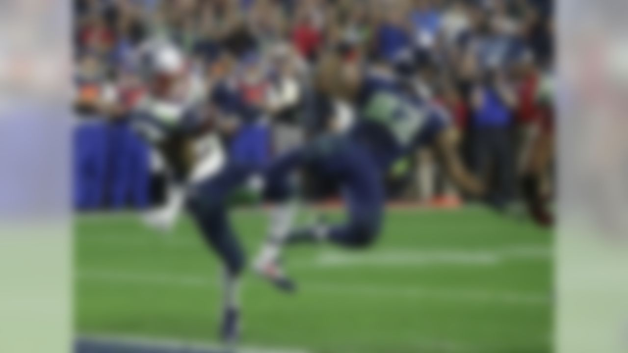Malcolm Butler's interception of a Russell Wilson pass in the end zone with 20 seconds remaining in the game preserved the Patriots' fourth Super Bowl win in the Bill Belichick-Tom Brady era. The Patriots entered the final quarter of play down 10 points to the Seahawks, but Brady rallied New England to victory with two fourth-quarter touchdown passes.