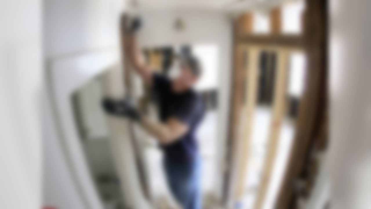 Tennessee Titans quarterback Kerry Collins tears out drywall in a house damaged by flooding on Wednesday, May 12, 2010, in Nashville, Tenn. (AP Photo/Mark Humphrey)