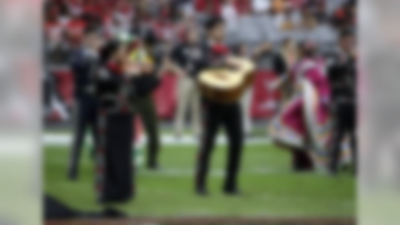 The Alma De Musica & Danza perform at half time of the Tampa Bay Buccaneers and the Arizona Cardinals football game in celebration of Hispanic heritage month Sunday, Sept. 18, 2016, in Glendale, Ariz. (AP Photo/Rick Scuteri)