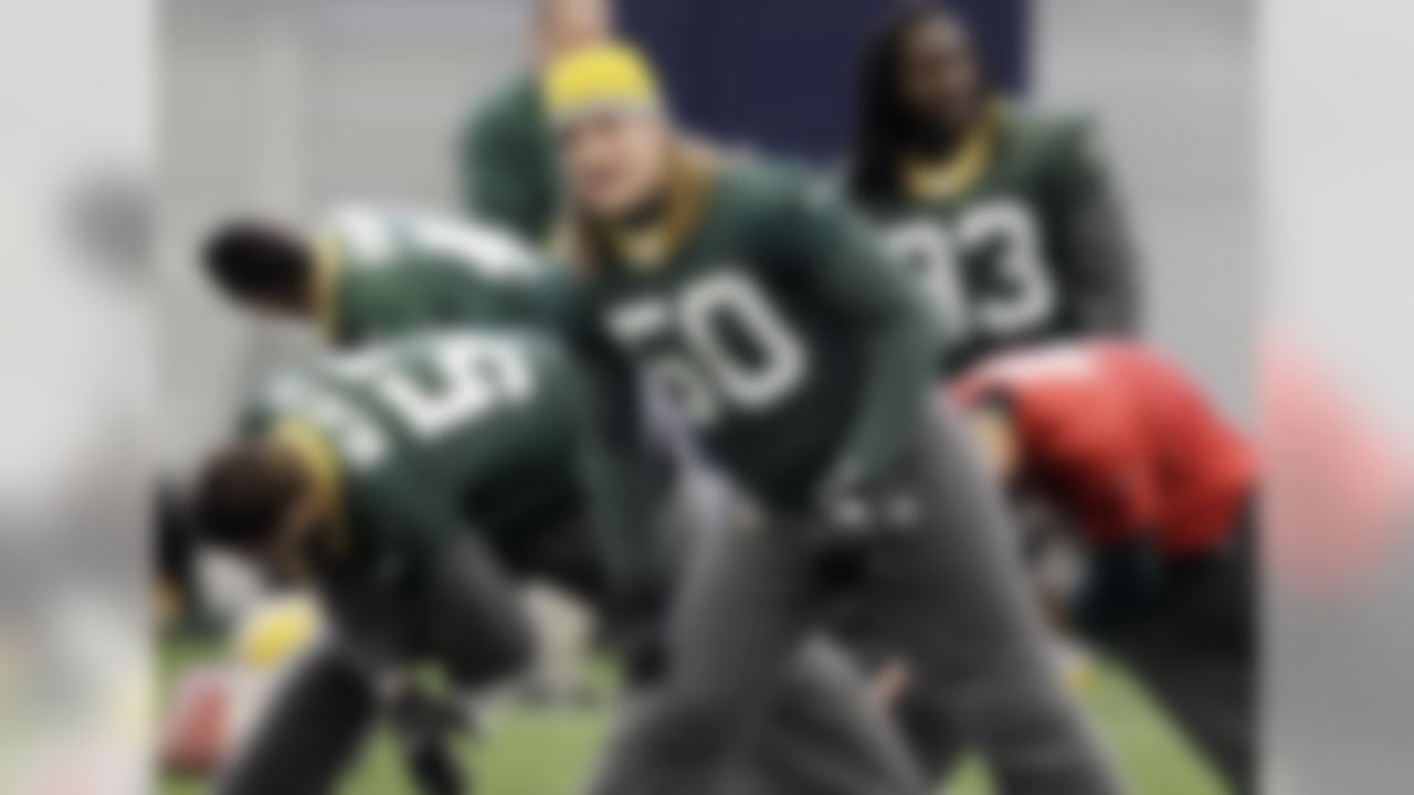 Green Bay Packers' A.J. Hawk (50) stretches with teammates during practice, Thursday, Feb. 3, 2011, in Dallas. Green Bay will face the Pittsburgh Steelers in the NFL football Super Bowl XLV Sunday. (AP Photo/Eric Gay)