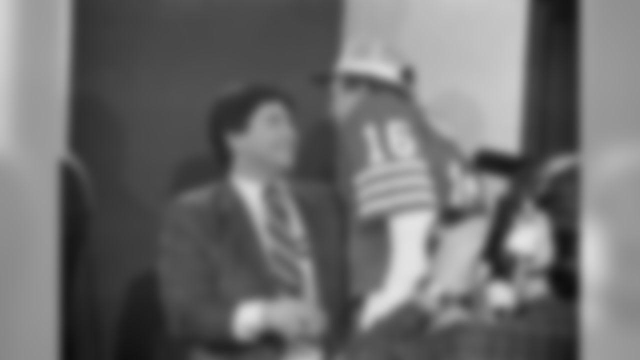San Francisco 49ers owner Edward DeBartolo Jr. congratulates quarterback Joe Montana (16) in lockerroom of Stanford Stadium, Sunday, Jan. 20, 1985 after the 'Niners beat the Miami Dolphins, 38-16, to win Super Bowl XIX. (Associated Press)