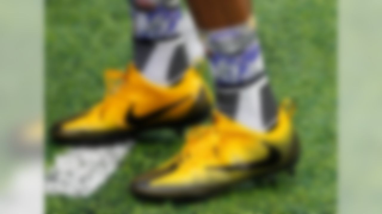 Though Patterson did not end up wearing these in the actual game, it is still hilarious to warm-up while wearing socks with your own face on them.