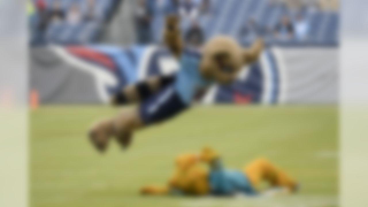 The Tennessee Titans mascot dives on a Jacksonville Jaguars mascot. (Mark Zaleski/Associated Press)