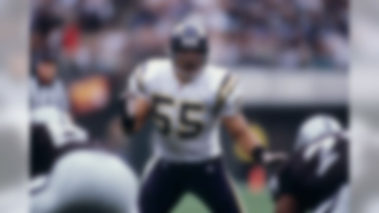 San Diego Chargers linebacker Junior Seau (55) calls a play during an NFL game against the Oakland Raiders, Sunday, Nov. 14, 1999 in Oakland. The Raiders won the game, 28-9. (AP Photo/Greg Trott)