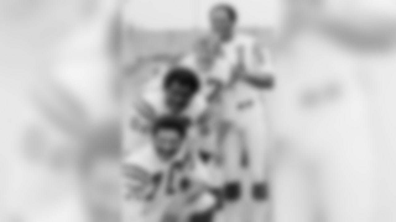 From bottom, Jim Marshall, Alan Page, Gary Larsen and Carl Eller, Minnesota Vikings linemen, are shown at Rice Stadium, Jan. 7, 1974 in Houston. (AP Photo)
