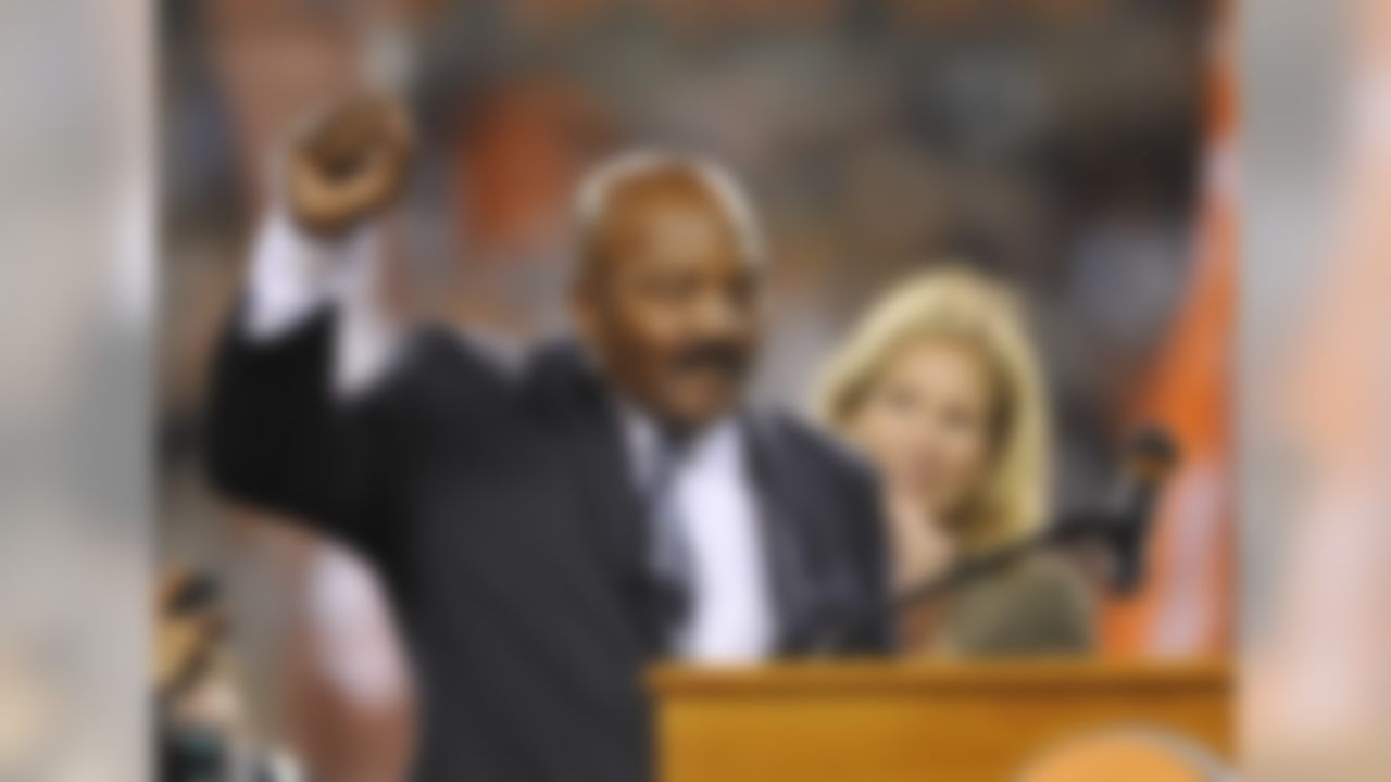 Cleveland Browns Hall of Fame running back Jim Brown acknowledges the crowd after being honored at halftime of an NFL football game between the Browns and the Buffalo Bills on Thursday, Oct. 3, 2013, in Cleveland. (AP Photo/David Richard)