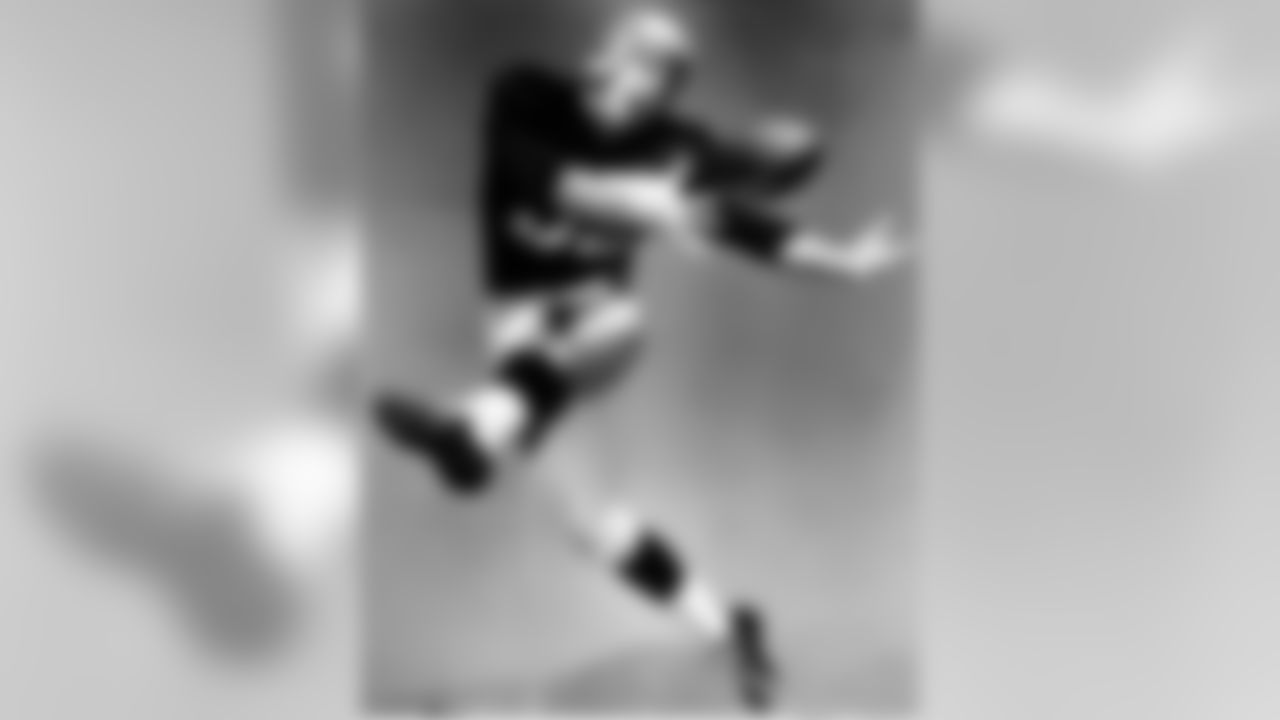 Wide receiver Tom Fears of the Los Angeles Rams poses for a picture in 1948. After Rams coaches switched him to offense from a defensive back, Fears went on to lead the league in receptions in each of his first three NFL seasons. He improved his total each year, setting a new league record with 77 catches in 1949 and then smashing his own mark with 84 in 1950. His career marks include 400 receptions for 5,397 yards and 38 touchdowns. (Photo by Vic Stein/NFL)
