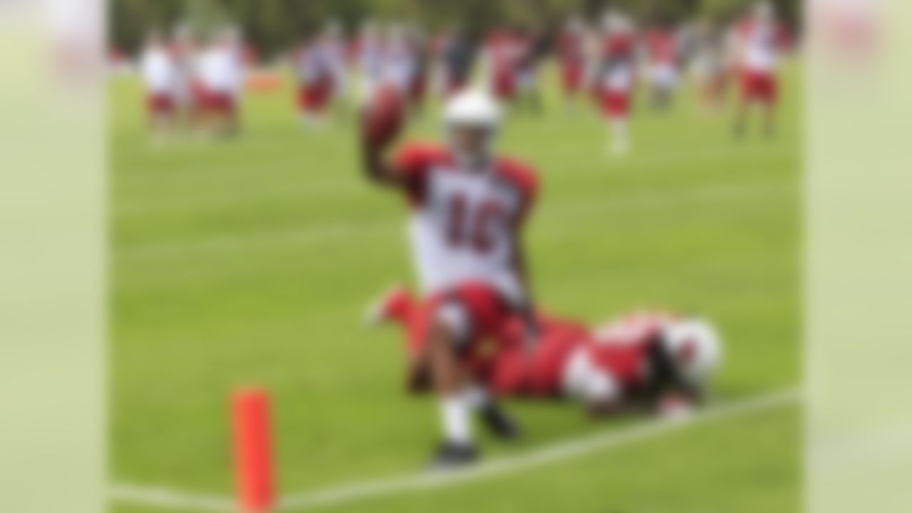 Arizona Cardinals' DeMarco Sampson (10) celebrates his touchdown catch as Greg Toler (28) stays on the ground during NFL training camp football practice at Northern Arizona University Friday, July 27, 2012, in Flagstaff, Ariz.(AP Photo/Ross D. Franklin)