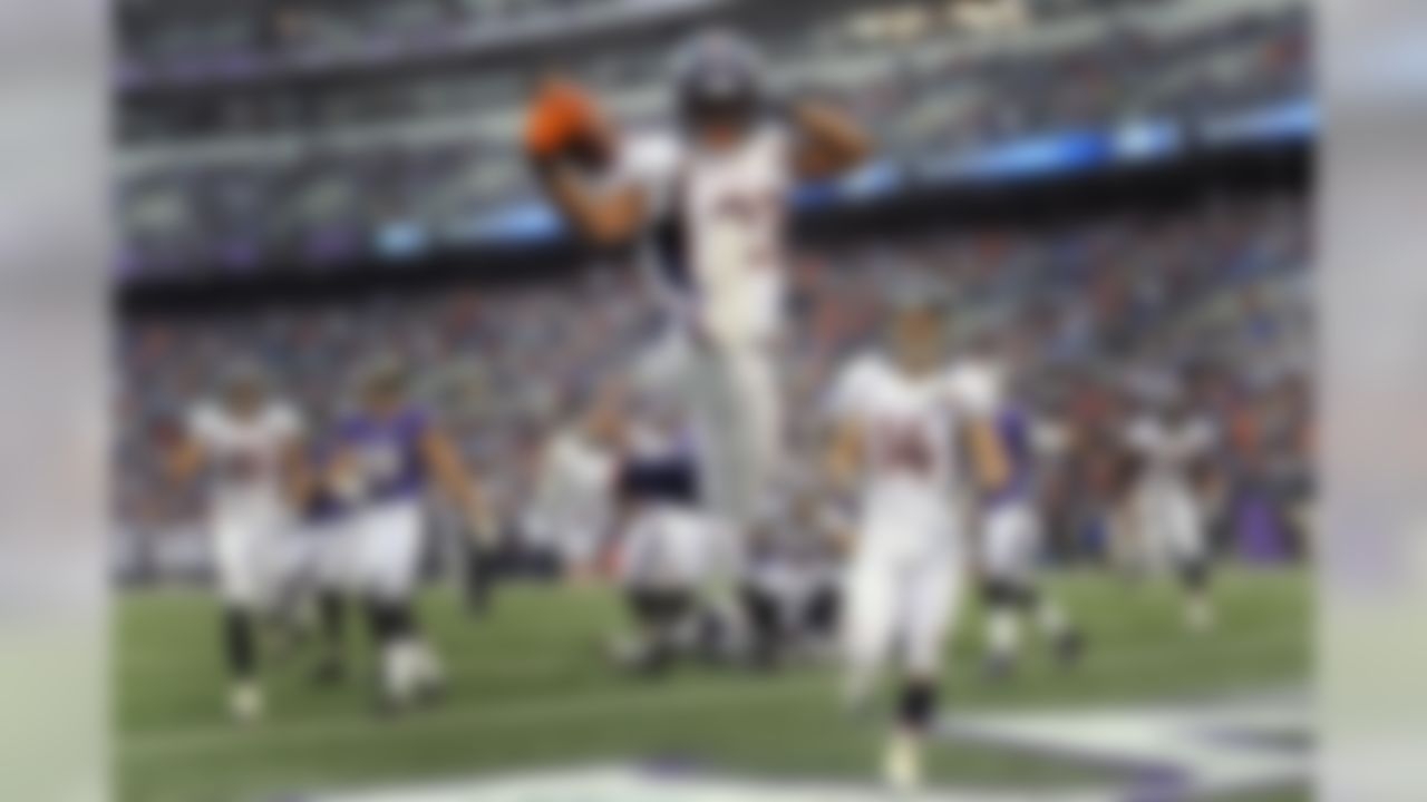 Denver Broncos running back Knowshon Moreno leaps into the air to celebrate his touchdown during the second half of an NFL football game against the Baltimore Ravens in Baltimore, Sunday, Dec. 16, 2012. (AP Photo/Nick Wass)
