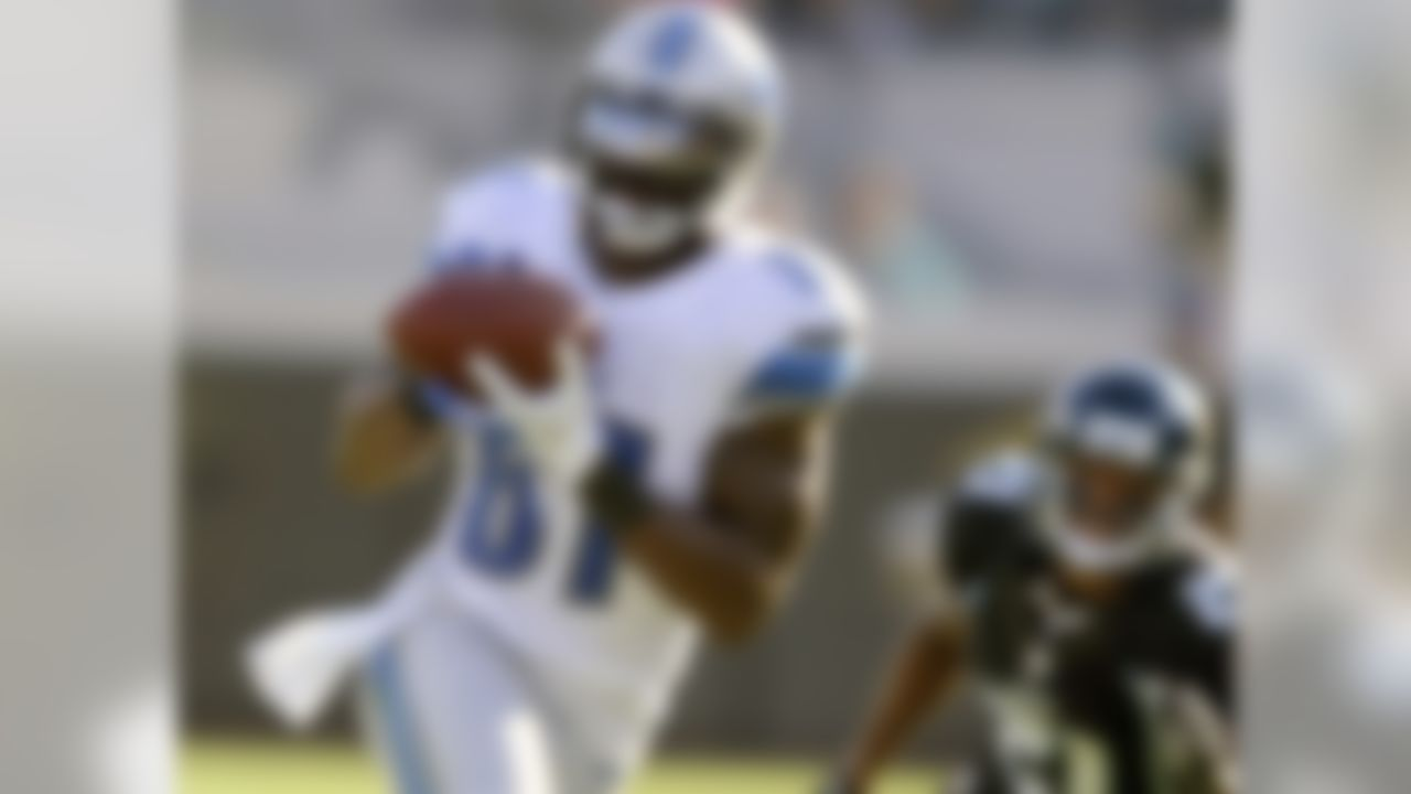 Detroit Lions wide receiver Calvin Johnson (81) catches a pass against Jacksonville Jaguars cornerback Derek Cox (21) during the second half of an NFL football game, Sunday, Nov. 4, 2012, in Jacksonville, Fla. Detroit beat Jacksonville 31-14. (Stephen Morton/Associated Press)