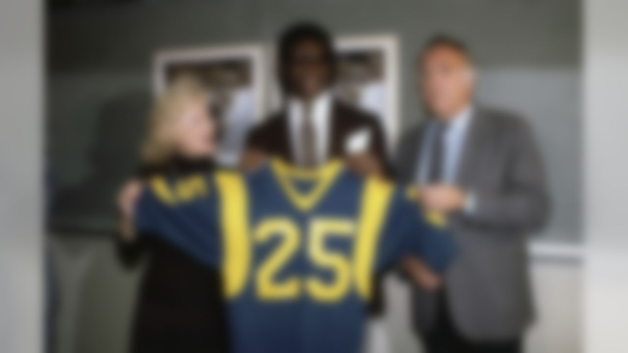 Eric Dickerson, Football Player, SMU running back L.A. Rams 1st round draft choice, with Rams owner, Georgia Frontiere and Coach John Robinson at news conference on April 26, 1983 in Anaheim, California. (AP Photo/Gary Ambrose)