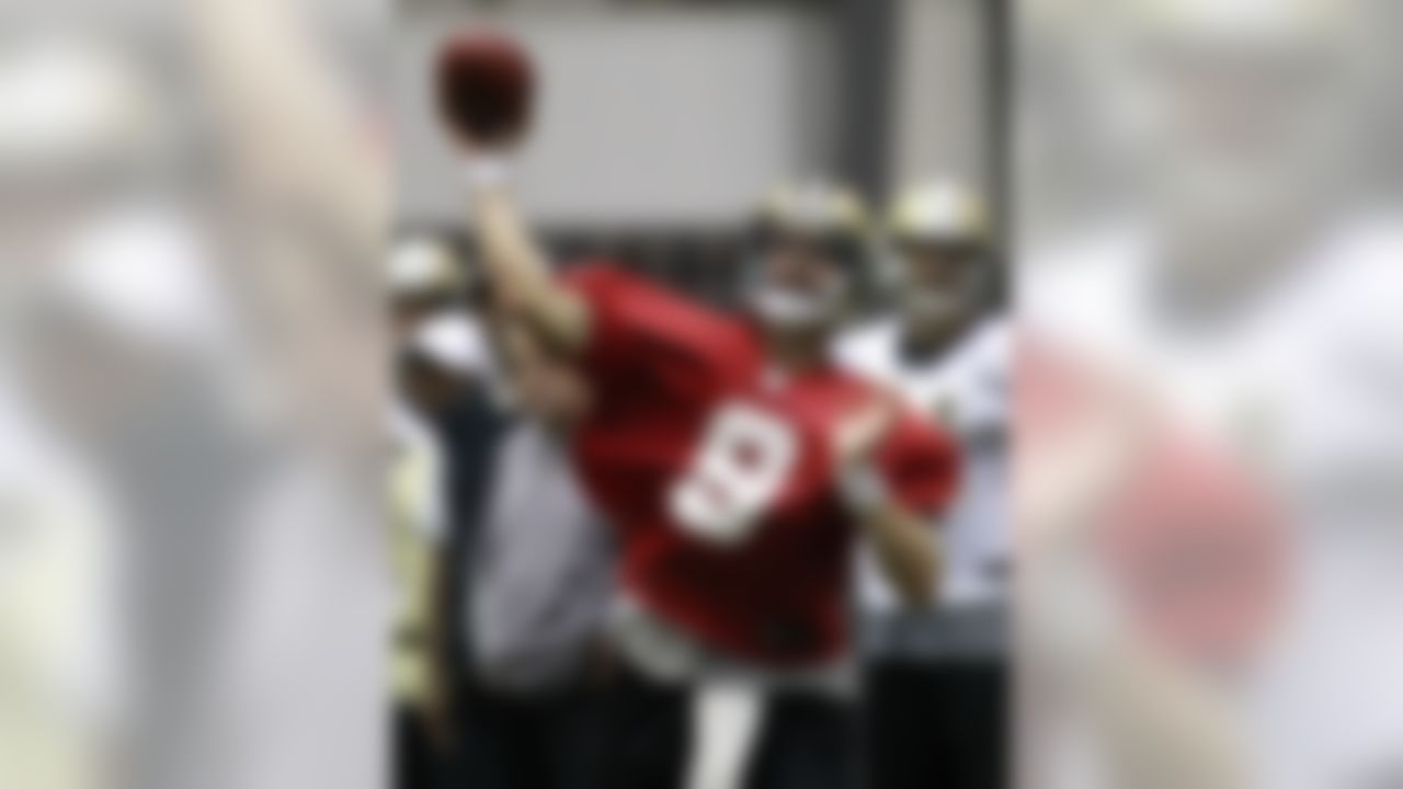 New Orleans Saints quarterback Drew Brees (9) passes during training camp at their indoor NFL football training facility in Metairie, La., Friday, July 27, 2012. (AP Photo/Gerald Herbert)