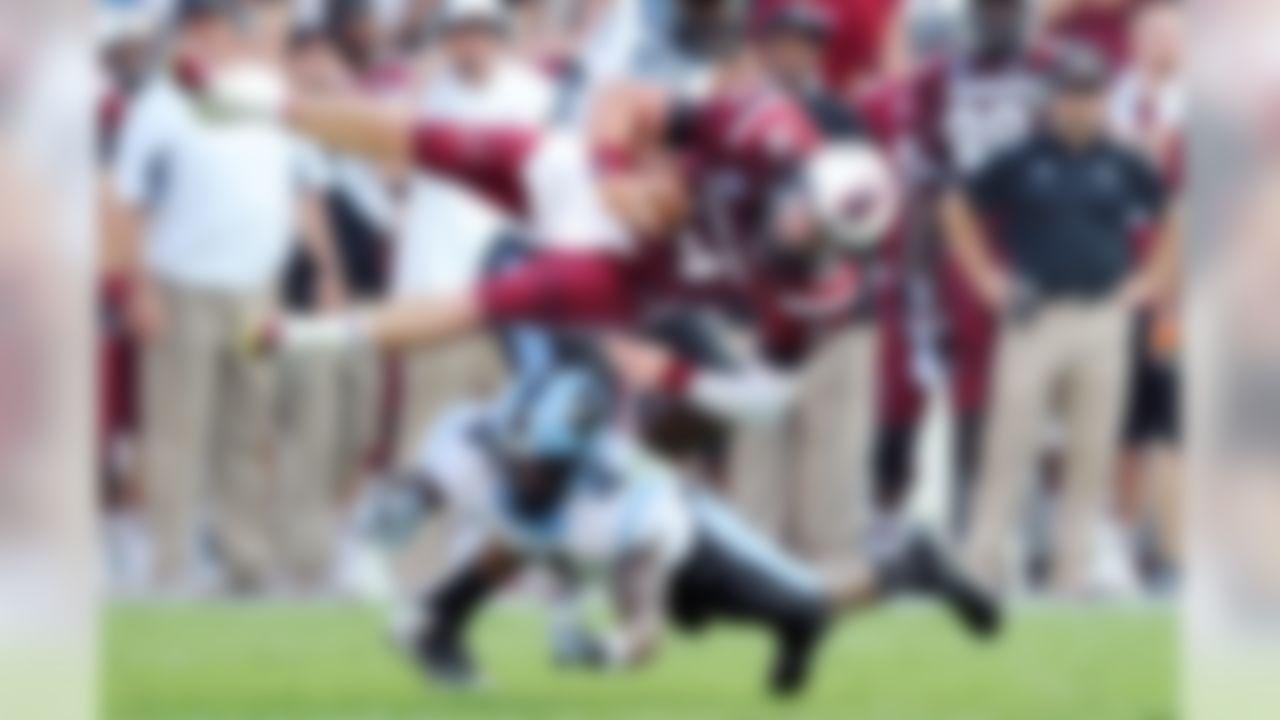 South Carolina quarterback Connor Shaw is tackled by North Carolina cornerback Jabari Price. (AP Photo/Stephen Morton)